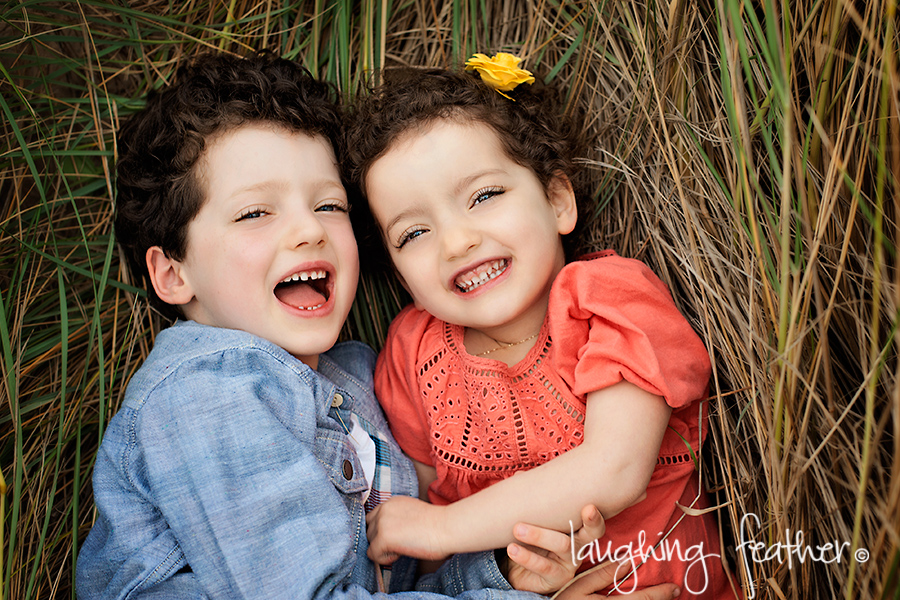 brother and sister beach portrait in reeds