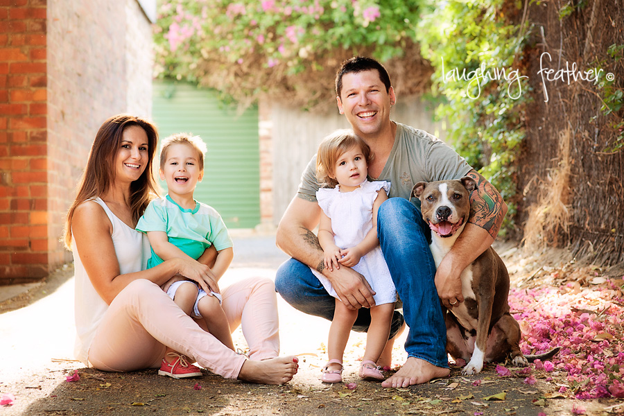 Family portrait in alley way with dog