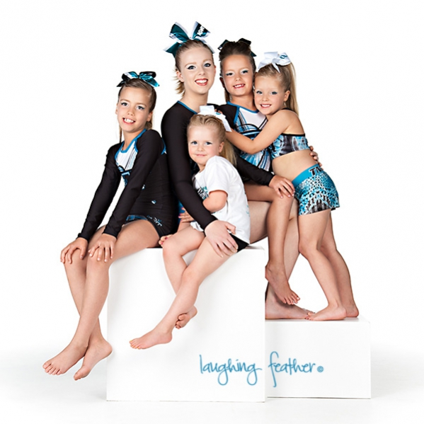 five sisters in cheerleading outfits family studio portrait